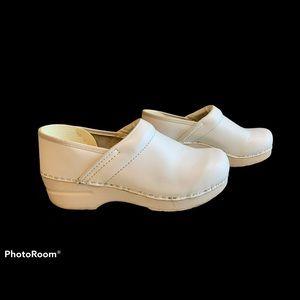 Dansko white leather slip on nursing clogs 38